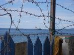 ...окружена забором и колючкой, во избежание нападений папуасов