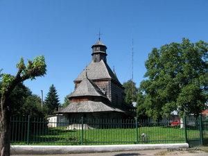 Пробежав через город, улица Жупна  встречается с  улицой  Зварицкой, а там — очарование города — старая деревянная церковь Воздвижения Честного Креста.