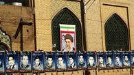 Портреты шахидов, погибших в войне с Ираком